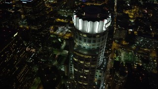 AX69_119 - 5K stock footage aerial video bird's eye view of US Bank Tower in Downtown Los Angeles at night, California