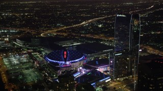 AX69_125 - 5K stock footage aerial video of Staples Center, Nokia Theater and Ritz-Carlton in Downtown Los Angeles, California at night