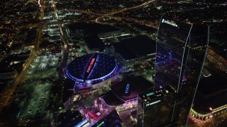 AX69_126 - 5K stock footage aerial video approach and tilt to Staples Center and Nokia Theater in Downtown Los Angeles, California at night