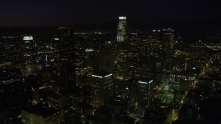 AX69_129 - 5K stock footage aerial video of a view of US Bank Tower and skyscrapers in Downtown Los Angeles, California at night