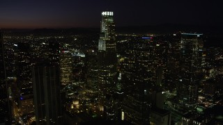 AX69_130 - 5K stock footage aerial video of US Bank Tower and skyscrapers in Downtown Los Angeles, California at night