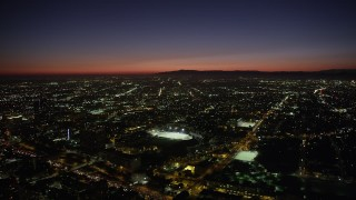 AX69_133 - 5K stock footage aerial video of Contreras High School Stadium at night in Westlake, Los Angeles, California