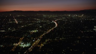 AX69_134 - 5K stock footage aerial video of heavy traffic on Highway 101 and East Hollywood neighborhoods at night, California