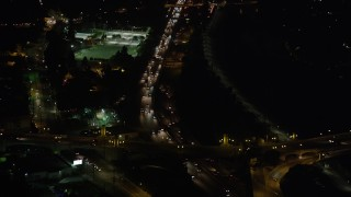 AX69_137 - 5K stock footage aerial video of heavy traffic on Interstate 5 through Los Feliz, Los Angeles, California