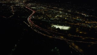 AX69_139 - 5K stock footage aerial video of heavy traffic on the I-5 and Highway 134 Interchange in Glendale at night, California