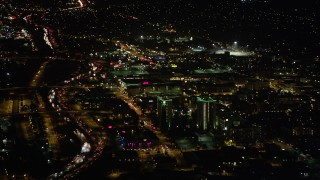 AX69_142 - 5K stock footage aerial video approach Holiday Inn and Burbank Town Center in Burbank, California at night