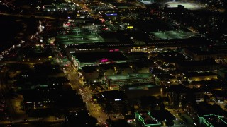 AX69_143 - 5K stock footage aerial video approach and fly over Burbank Town Center in Burbank, California at night