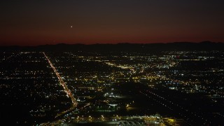 AX69_145 - 5K stock footage aerial video of runways at Burbank Airport and suburban neighborhoods at night, California