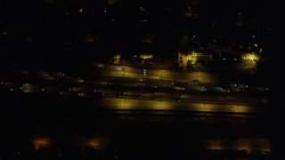 AX69_148 - 5K stock footage aerial video of a bird's eye view of I-5 with light traffic at night in Burbank, California