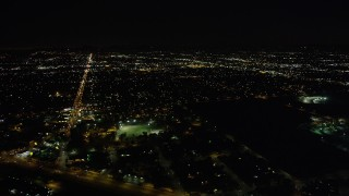 AX69_150 - 5K stock footage aerial video of suburban neighborhoods at night in Sun Valley, California