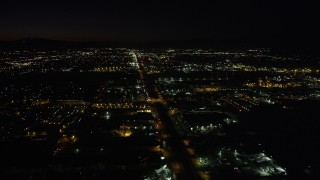 AX69_151 - 5K stock footage aerial video of warehouse buildings on San Fernando Road at night in Pacoima, California