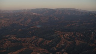 AX70_006 - 4K stock footage aerial video Approach a lake in the Los Padres National Forest at sunrise, California