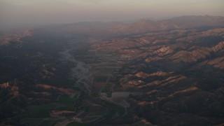 AX70_007 - 4K stock footage aerial video Farm fields by the Santa Clara River at sunrise, Piru, California