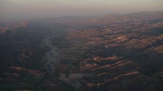 AX70_008 - 4K stock footage aerial video Farmland by the Santa Clara River at sunrise, Piru, California