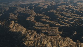 AX70_019 - 4K stock footage aerial video Pass mountain ridges in Los Padres National Forest at sunrise, California