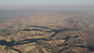AX70_030 - 4K stock footage aerial video Mountain ridges at sunrise, Cuyama, California