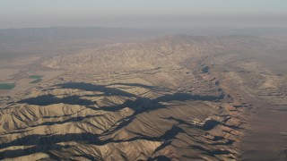 AX70_031 - 4K stock footage aerial video Flyby mountain ridges at sunrise, Cuyama, California