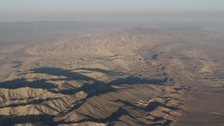 AX70_032 - 4K stock footage aerial video Rugged mountain ridges at sunrise, Cuyama, California