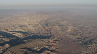 AX70_033 - 4K stock footage aerial video Mountain range at sunrise, Cuyama, California