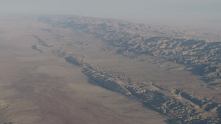AX70_036 - 4K stock footage aerial video Wide view of the San Andreas Fault, the Temblor Range, and desert plains in Southern California
