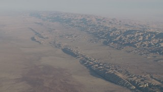 AX70_038 - 4K stock footage aerial video of The San Andreas Fault in a desert plain by the Temblor Range in Southern California