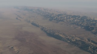 AX70_039 - 4K stock footage aerial video San Andreas Fault in a desert plain beside the Temblor Range in Southern California