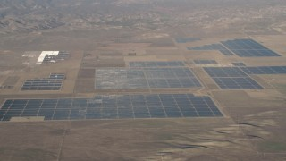 AX70_060 - 4K stock footage aerial video Large solar panels at the Topaz Solar Farm in the Carrizo Plain, California