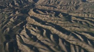 AX70_069 - 4K stock footage aerial video Passing desert hills in San Luis Obispo County, California