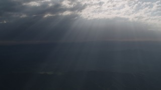 AX70_074 - 4K stock footage aerial video Godrays shining through the clouds over San Luis Obispo County, California