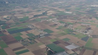 AX70_082 - 4K stock footage aerial video of A view of farms, greenhouses, and crop fields in Salinas, California