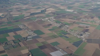 AX70_083 - 4K stock footage aerial video Farms, greenhouses, and crop fields in Salinas, California