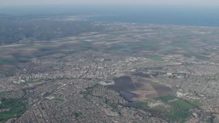 AX70_084 - Aerial stock footage of 4K Aerial Video Farm fields and suburban neighborhoods in Salinas, California