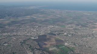 AX70_085 - Aerial stock footage of 4K Aerial Video Farm fields around suburban neighborhoods in Salinas, California
