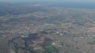 AX70_086 - Aerial stock footage of 4K Aerial Video of A view of farm fields around suburban neighborhoods in Salinas, California