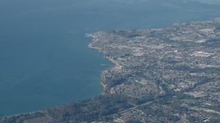 AX70_087 - 4K stock footage aerial video Flying by the coastal city of Santa Cruz, California