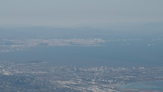 AX70_093 - 4K stock footage aerial video San Francisco, the Bay Bridge, and San Francisco Bay seen from San Mateo, California