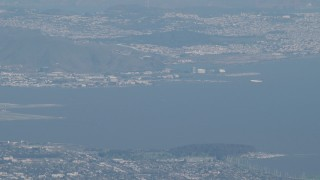 AX70_096 - Aerial stock footage of 4K Aerial Video Commercial airliner flying near San Francisco International Airport in California
