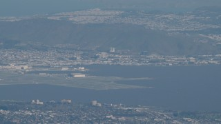AX70_097 - 4K stock footage aerial video Commercial jet flying by San Francisco International Airport in California