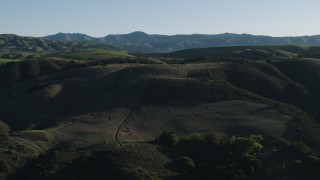 AX70_099 - 4K stock footage aerial video Green hills in springtime, Gilroy, California