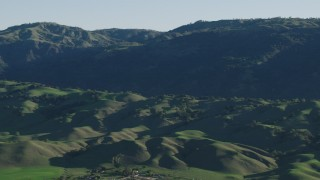 AX70_101 - 4K stock footage aerial video Flyby green hills and mountains in springtime, Gilroy, California