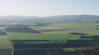 AX70_104 - 4K stock footage aerial video Fly over large crop fields in Hollister, California