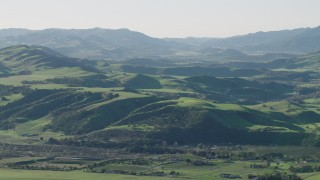AX70_113 - 4K stock footage aerial video Approach farms and green hills in Hollister, California