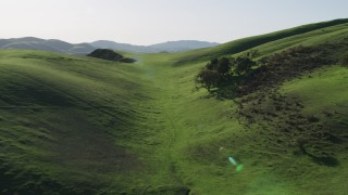 AX70_124 - 4K stock footage aerial video Green hills in Hollister, California