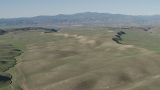 AX70_167 - 4K stock footage aerial video Rolling green hills in San Benito County, California