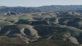 AX70_169 - 4K stock footage aerial video Flyby green hills with trees in San Benito County, California