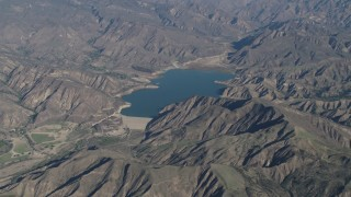 AX70_186 - 4K stock footage aerial video of Santa Felicia Dam and Lake Piru in Los Padres National Forest, California