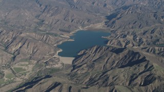 AX70_187 - 4K stock footage aerial video The Santa Felicia Dam and Lake Piru in the Los Padres National Forest, California