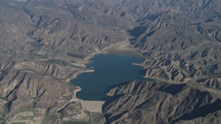AX70_188 - 4K stock footage aerial video Flying by the Santa Felicia Dam and Lake Piru in the Los Padres National Forest, California