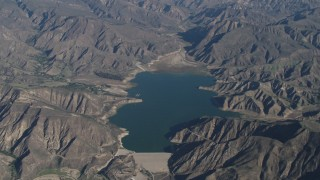 AX70_189 - 4K stock footage aerial video Santa Felicia Dam by Lake Piru in the Los Padres National Forest, California