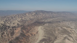 AX70_203 - 4K stock footage aerial video Flyby a rugged desert mountains in the Caliente Mountain Range, California